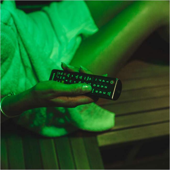 Woman watching tv in infrared sauna